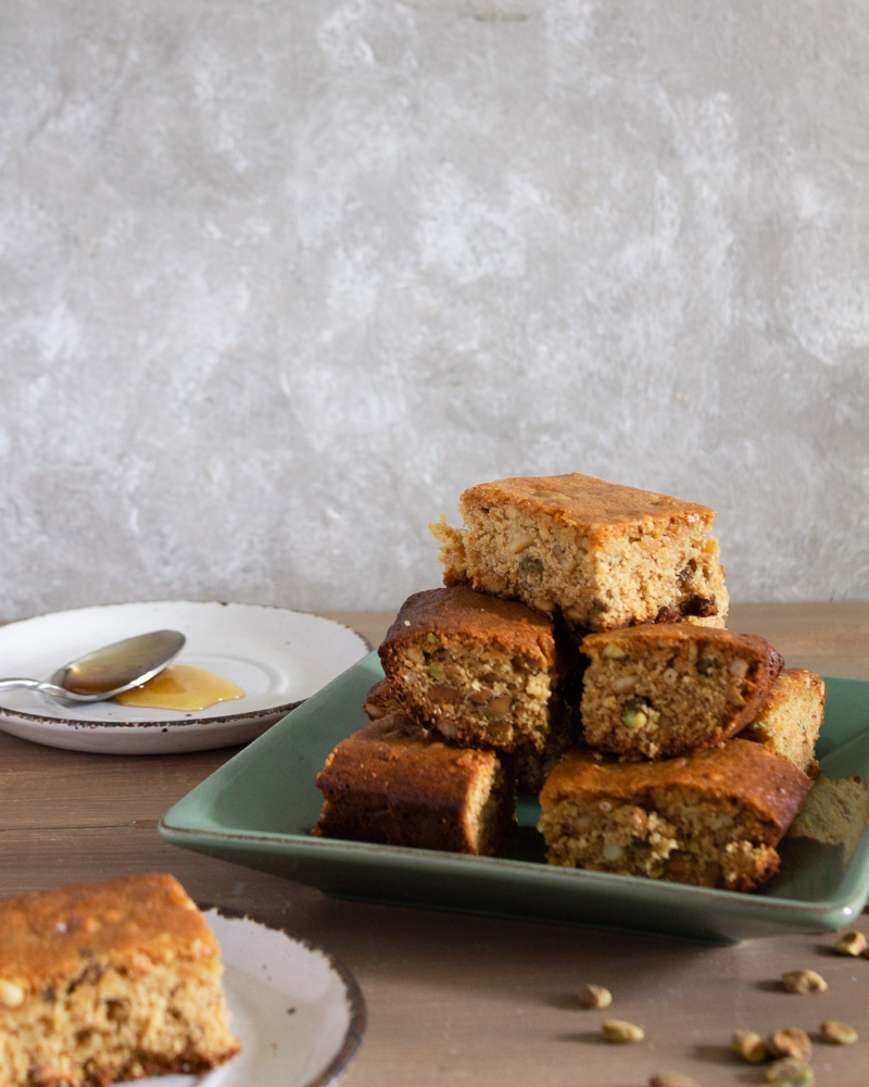 Baklava blondies with honey on plate and piece in front