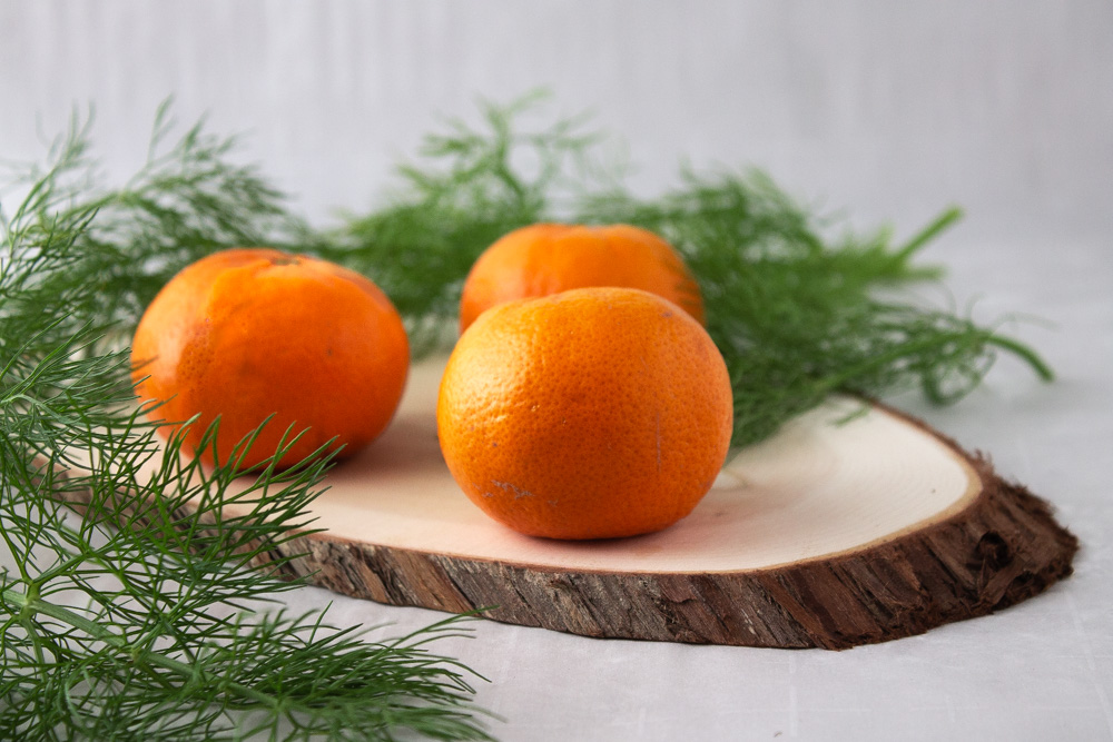 mandarins and fennel on wood