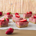 Strawberry bars on parchment side shot