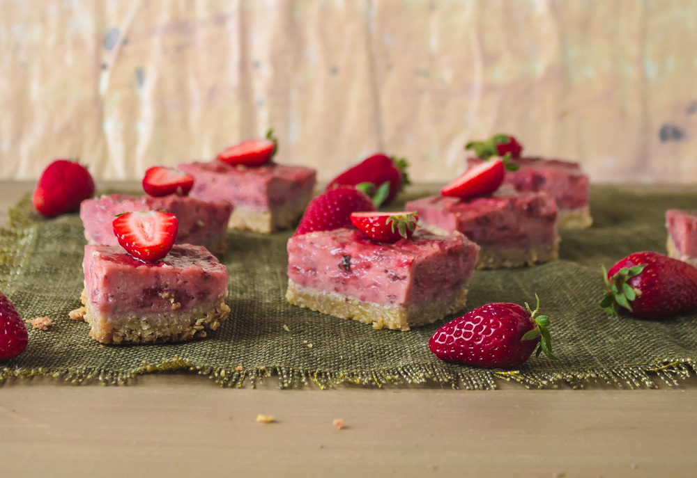 Side shot of strawberry bars on green placemat