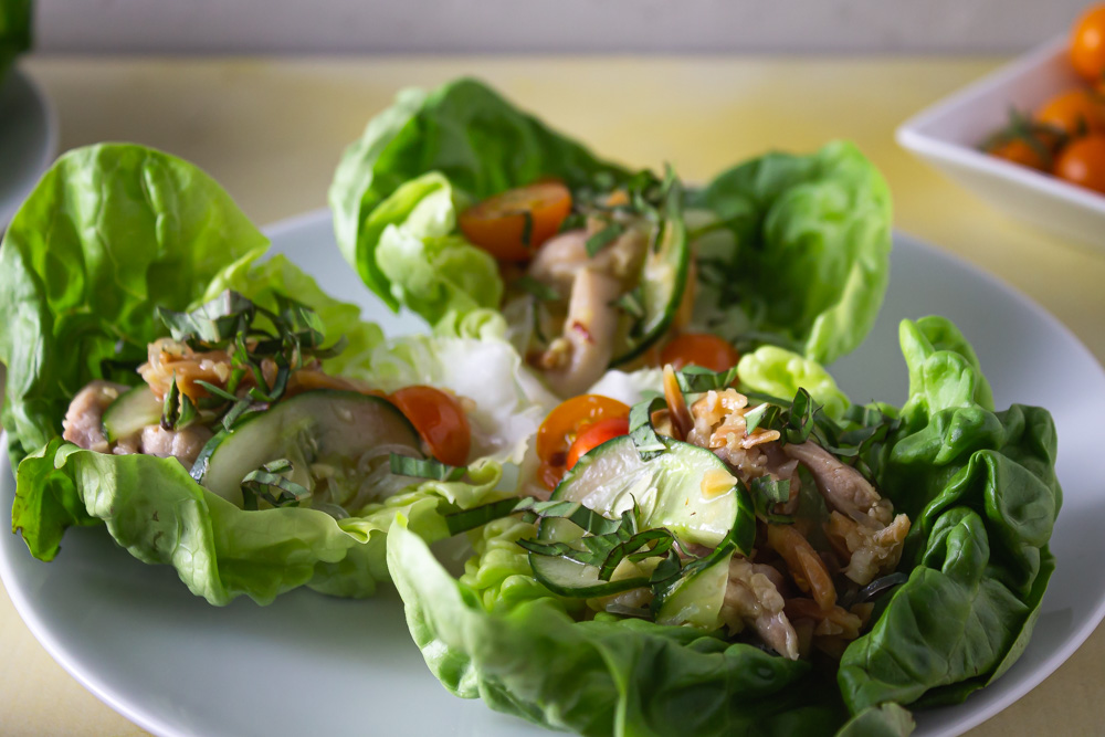 Close up of 3 lettuce wraps on white plate