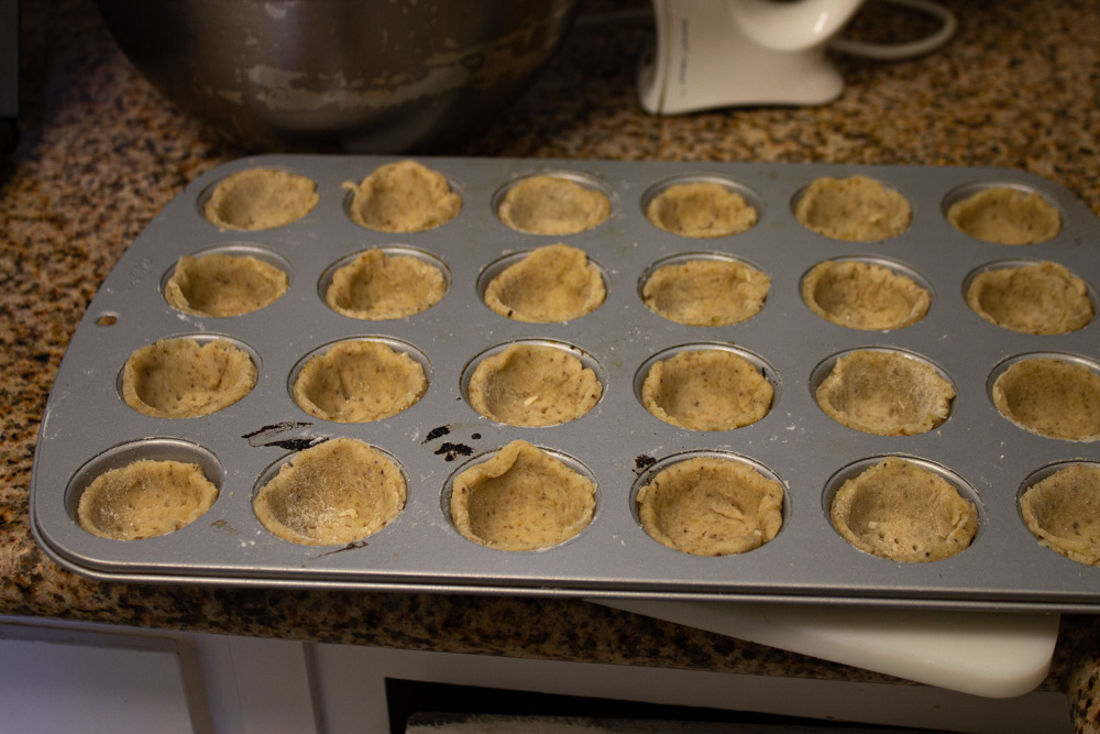 Pastry cases in the pan ready to be baked
