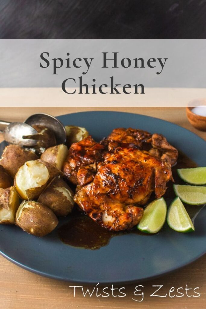 angled shot of honey chicken with writing