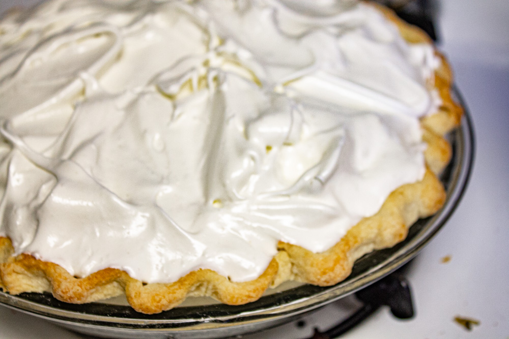 Stiff meringue on pie ready for oven