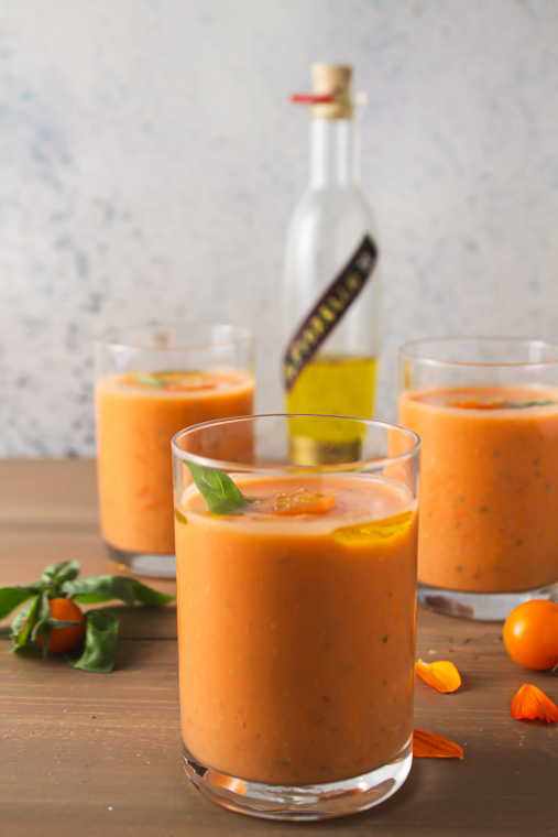 Three glasses of corn tomato gazpacho with lime olive oil