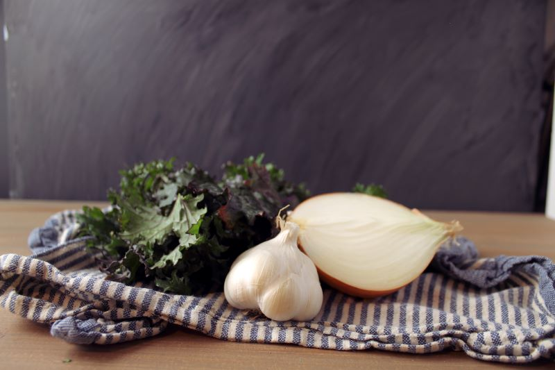 Onion, kale and garlic for the quiche flavors