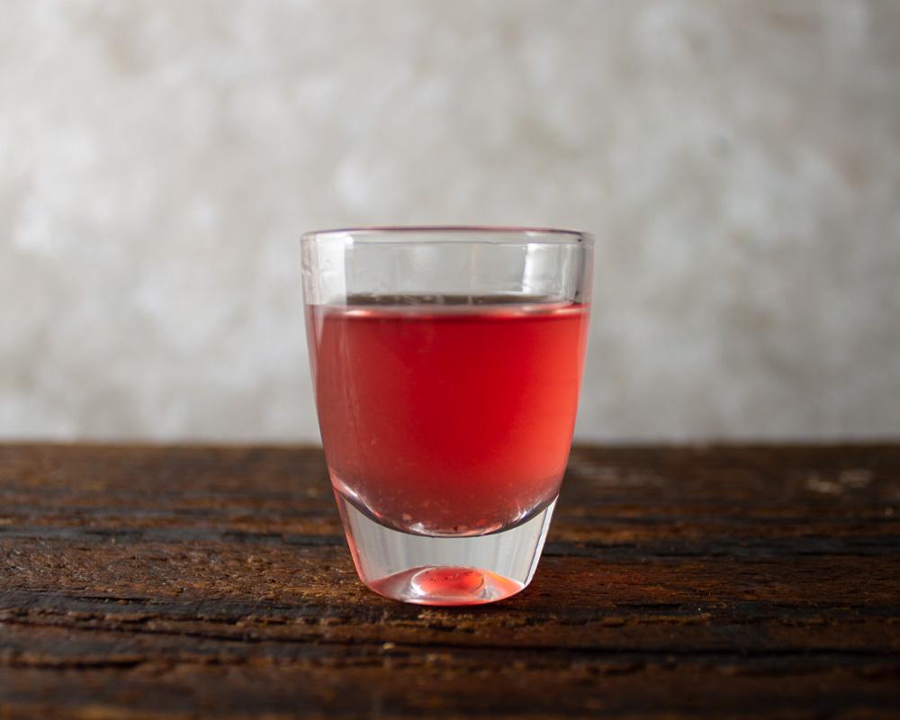 Pomegranate spice liqueur in glass