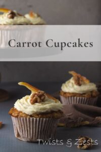 Two carrot cupcakes with some on stand