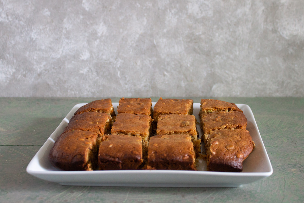 Cut baklava blondies on white plate
