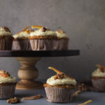Carrot cupcakes with several on cake stand