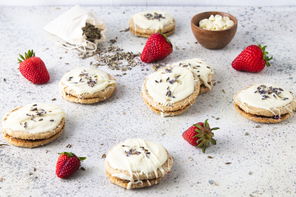 45 degree angle shot of strawberry lavender cookies with all white background