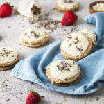 Strawberry lavender sandwich cookies with a blue napkin