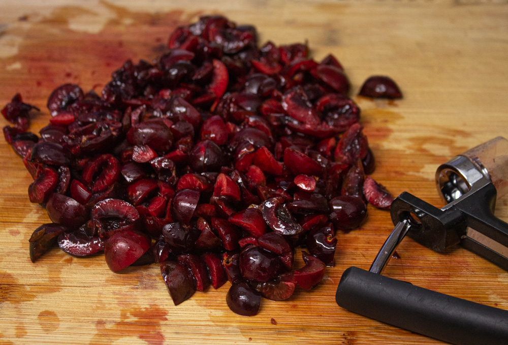 Chopped cherries on a cutting board