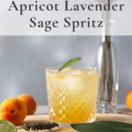 Apricot spritz in a rocks glass with lavender and sage