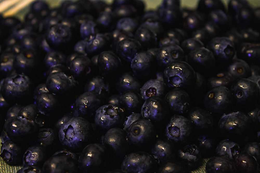 Large pile of blueberries