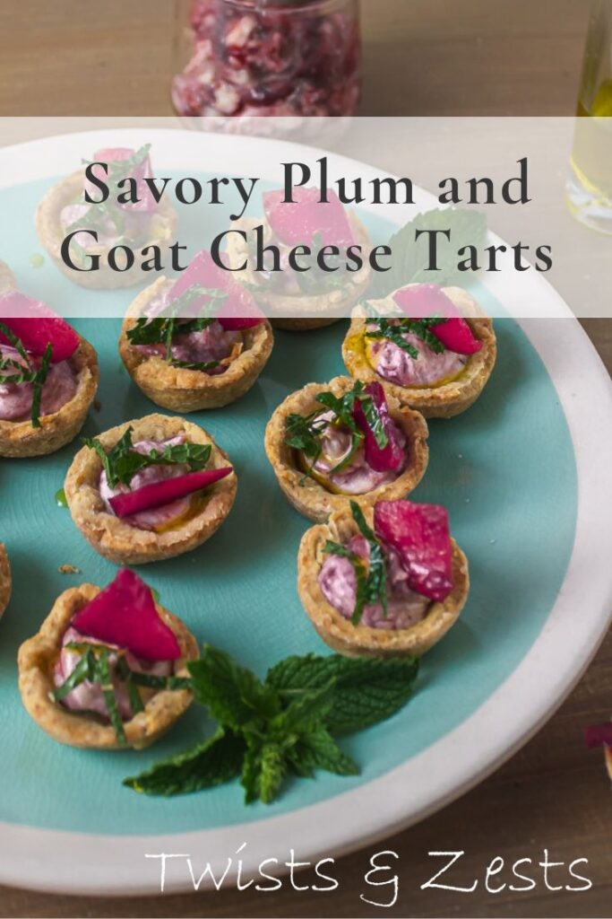 Angled shot of plum goat cheese tarts on green plate with text