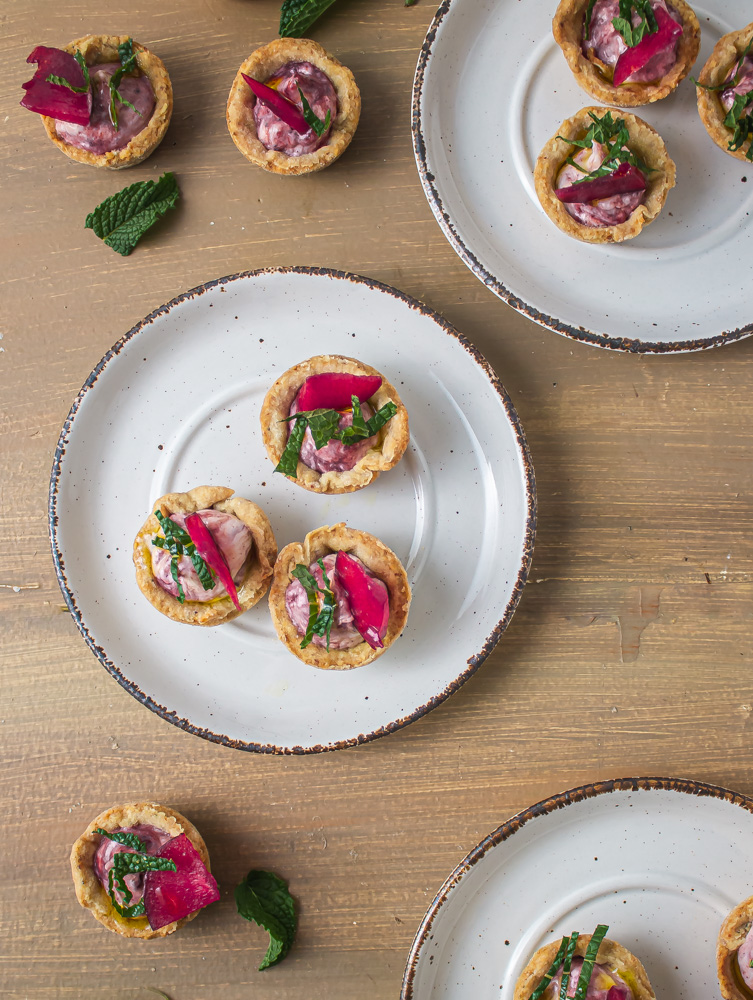 3 plates of plum goat cheese tarts