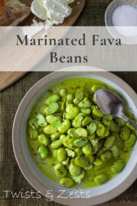 Overhead shot of fava beans with writing