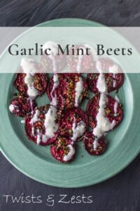 Garlic Mint Roasted Beets on green plate