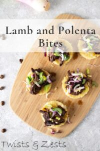 Overhead view of lamb and polenta on a cutting board