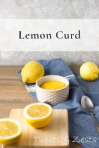 lemon curd and lemons on a blue towel