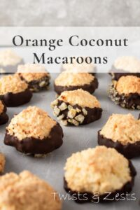 Orange coconut macaroons dipped in dark chocolate with text