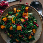 Overhead shot of swiss chard and buttern nut squash with pomegranates