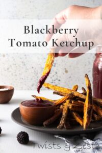 sweet potato fry dipping in blackberry ketchup