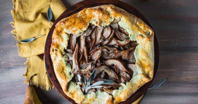 Overhead shot of olive oil pear galette on stand
