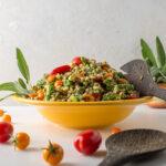 Sage pesto farro salad in yellow bowl