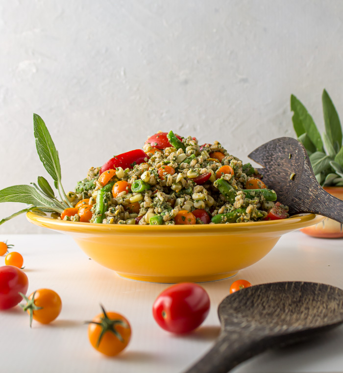 Sage pesto farro salad in yellow bowl