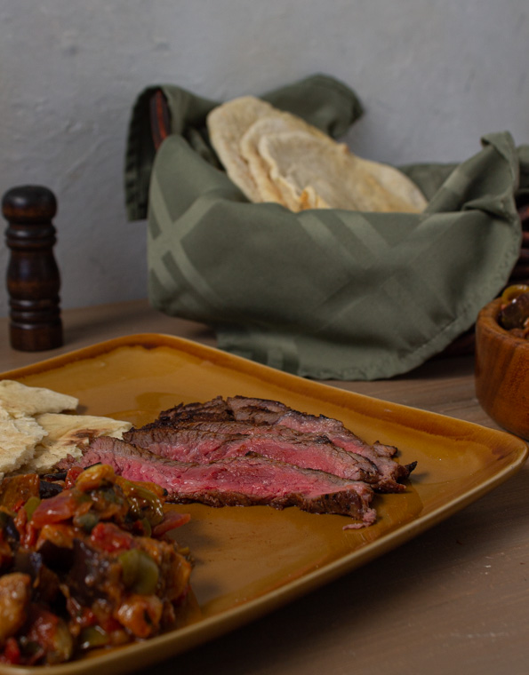 marinated steak with flatbread and caponata